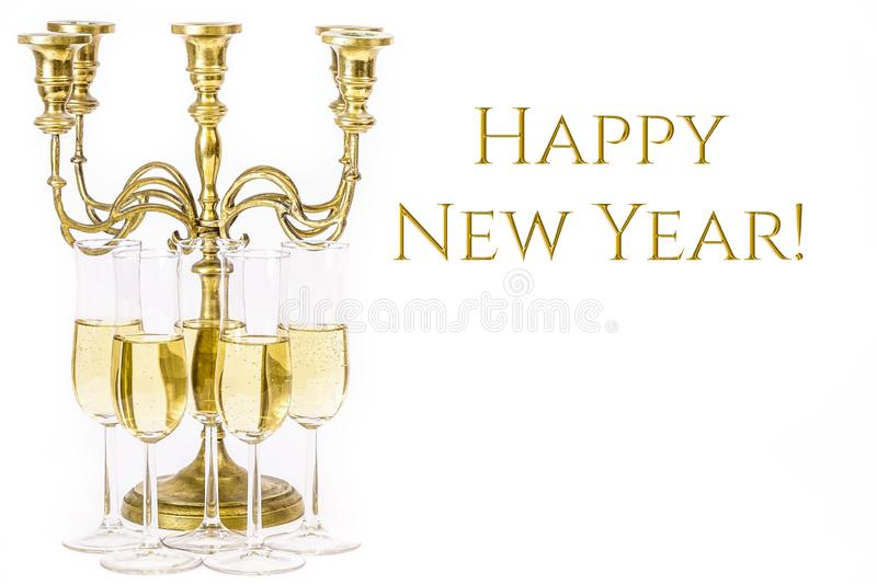 Happy New Year!. Elegant, simple image. Glasses of champagne and candelabra. For new years eve celebration. Empty copy space for text on white background stock photo