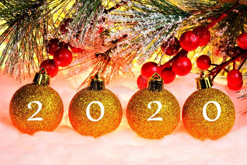 Happy new year 2020-elegant spruce winter snow-covered branch, festive background glitter lights bokeh. Decoration of toys for royalty free stock images