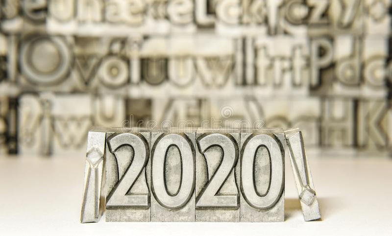 Happy new year 2020 between exclamation marks on background with press types royalty free stock photos