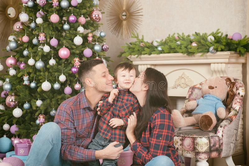 Happy new year family mother father child near christmas tree an stock photos