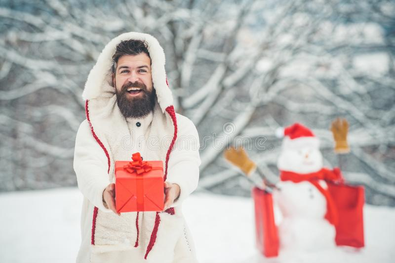 Happy new year. Happy father playing with a snowman on a snowy winter walk. Santa Claus wishes Merry Christmas. royalty free stock photos