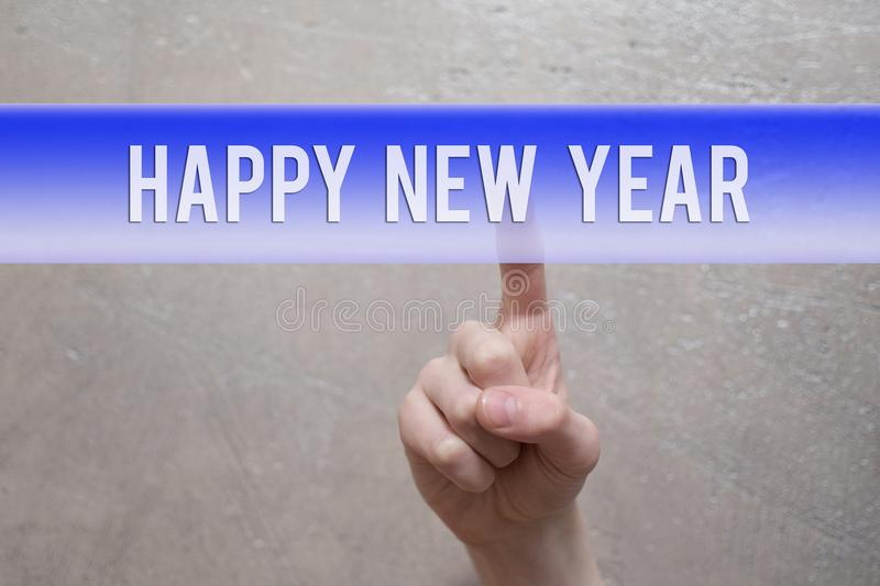 Happy new year - finger pressing blue virtual button royalty free stock images