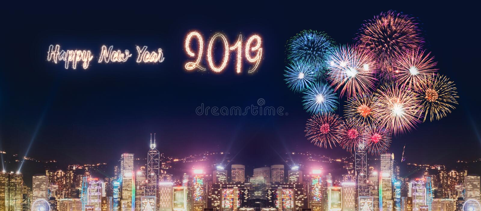 Happy new year 2019 firework over cityscape building near sea at royalty free stock photography