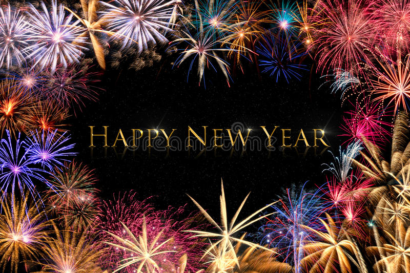 Happy New Year Fireworks Border. A colorful fireworks border on a black background with golden text Happy New Year royalty free stock images