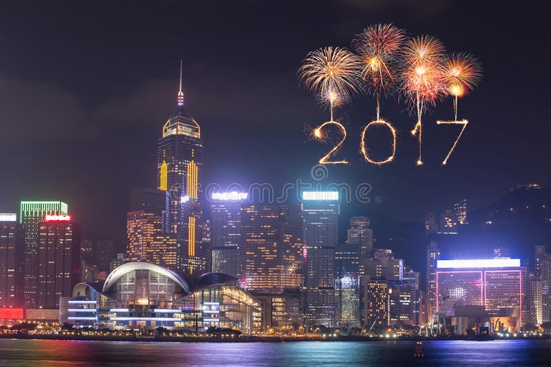 2017 Happy New Year Fireworks celebrating over Hong Kong city stock photo