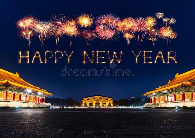 Happy new year fireworks over Chiang Kai-Shek Memorial Hall at night in Taipei, Taiwan royalty free stock photo