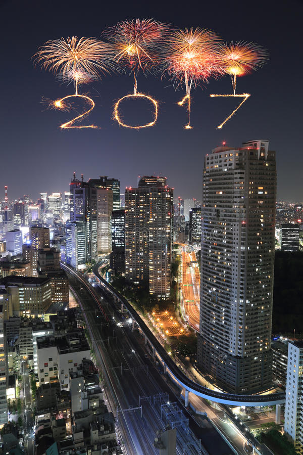 2017 Happy New Year Fireworks over Tokyo cityscape at night, royalty free stock photos