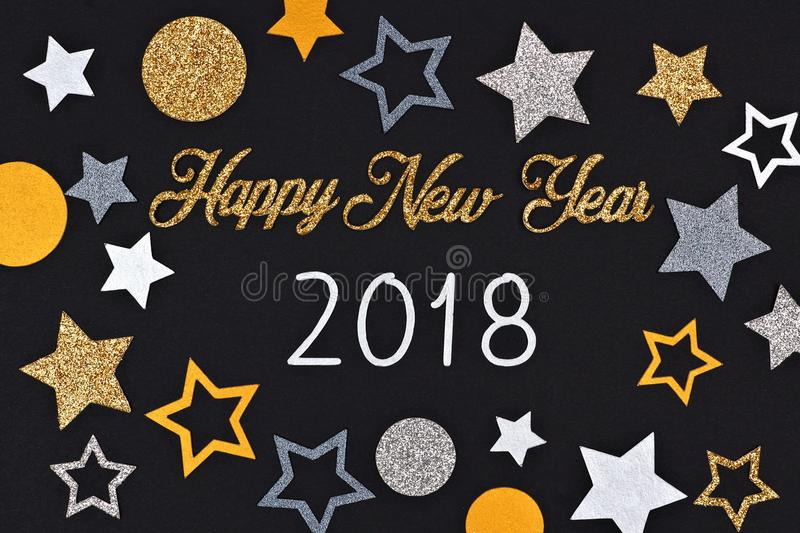 Happy New Year 2018 text with confetti against a black background royalty free stock images