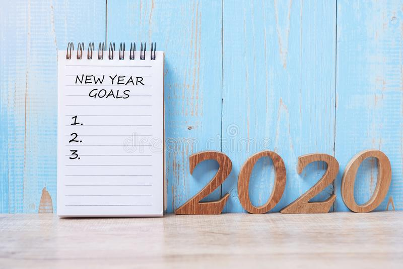 2020 Happy New Year Goals word on notebook and wooden number. time for a New Start, Resolution, Plan, Action and Mission Concept royalty free stock photo