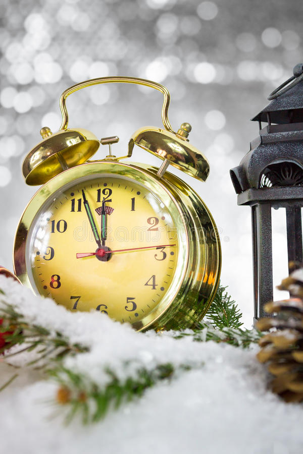 Happy New Year. Gold retro clock showing five to midnight stock photo