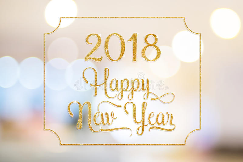 Happy New year 2018 gold sparkling glitter word with golden frame at abstract blurred bokeh light background, Holiday concept stock images