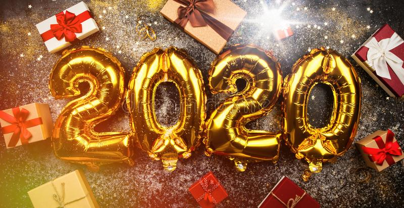 Happy New Year 2020. Golden balloons royalty free stock image