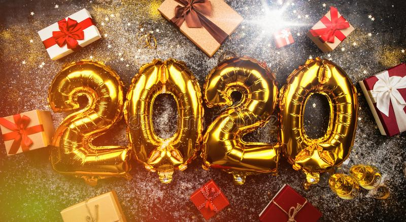 Happy New Year 2020. Golden balloons royalty free stock images