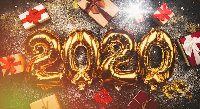 Happy New Year 2020. Golden balloons stock photo