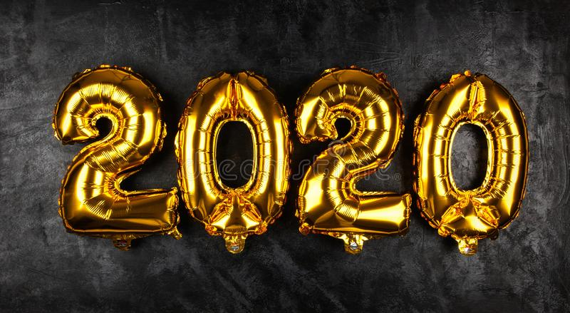 Happy New Year 2020. Golden baloons royalty free stock photo