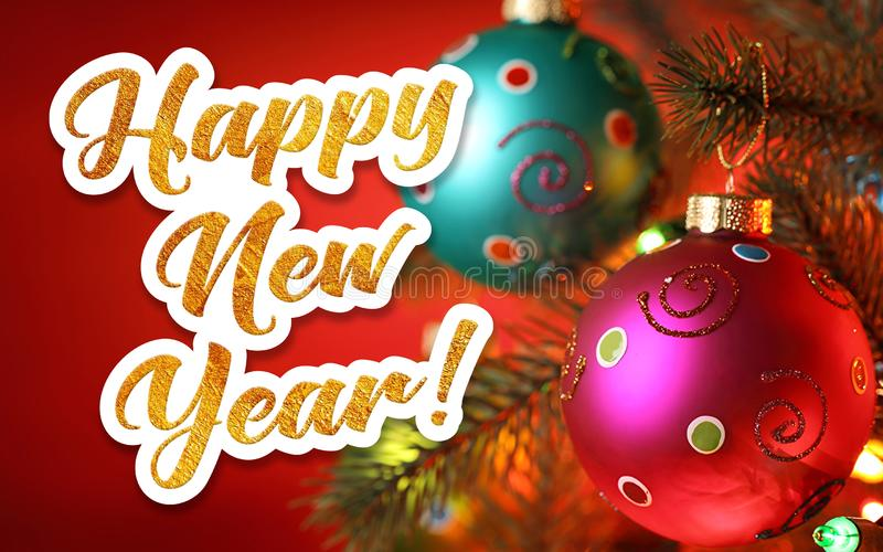 Happy New Year. Golden inscription on a festive background. Happy new year greeting written in gold letters on a festive background stock image