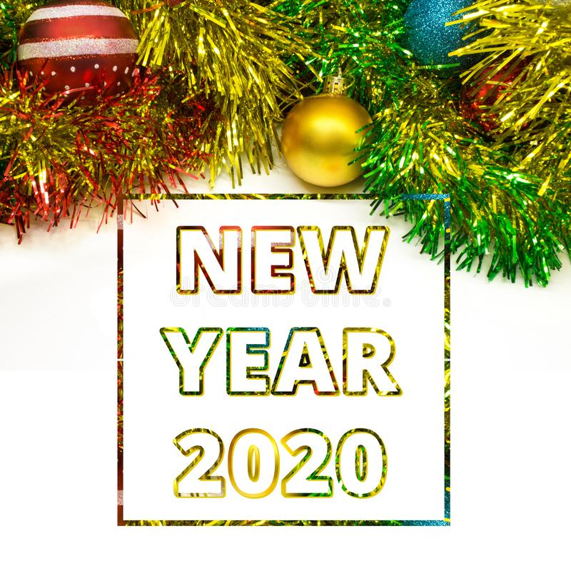 Happy new year 2020 greeting card. Congratulation decorated christmas balls and tinsel background concept stock image