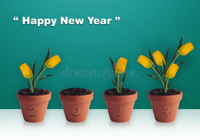 Happy New year. 2014, Group of yellow tulips in clay container stock photography