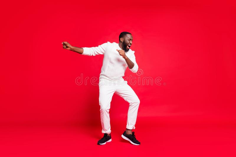 Happy new year guys. Full size photo of funny dark skin man dancing at newyear corporate party wear knitted sweater. Happy new year guys. Full size photo of royalty free stock images