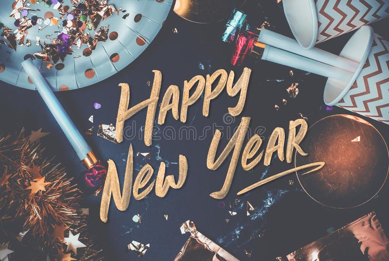Happy new year 2019 hand brush stroke font on marble table with. Party cup,party blower,tinsel,confetti.Fun Celebrate holiday party time table top view.blue stock images