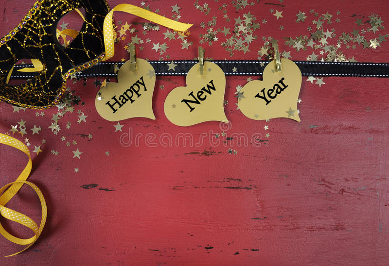Happy New Year haning hearts on red distressed wood. Happy New Year background with hanging hanging with sample text on red rustic distressed vintage wood royalty free stock images