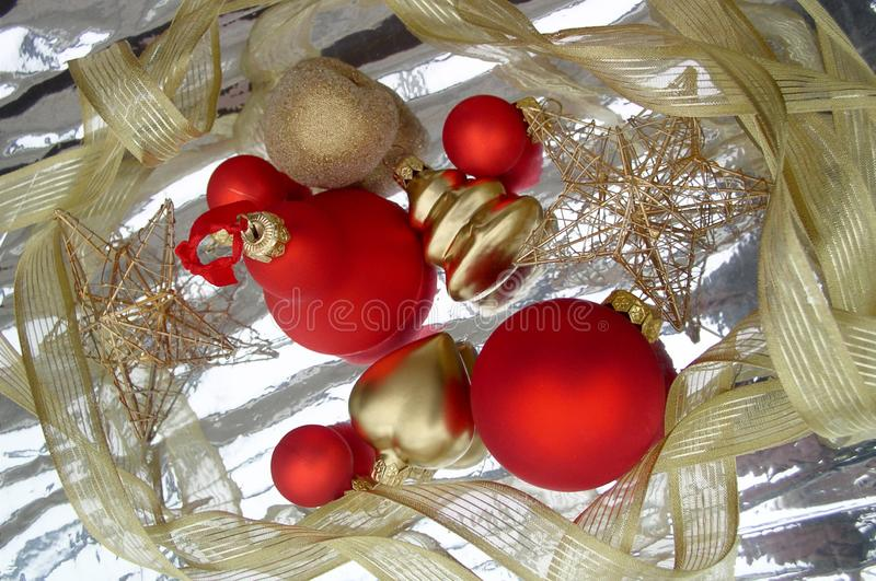 Happy New Year. Happiness. Red ball. Silver background. Gold ribbon. Congratulation. New Year`s celebration. An object. Star stock image