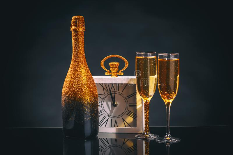 Happy New Year. Alarm clock and champagne royalty free stock photo