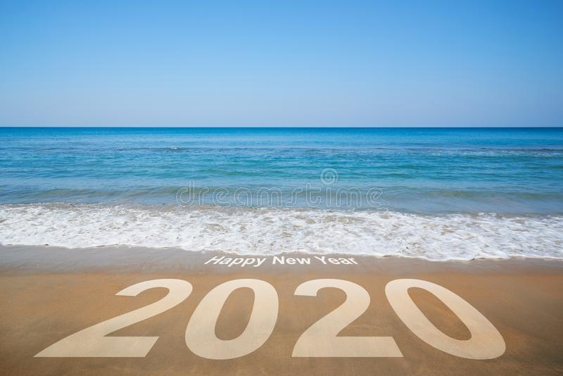 Happy new year 2020. Beautiful beach on blue sky background royalty free stock images