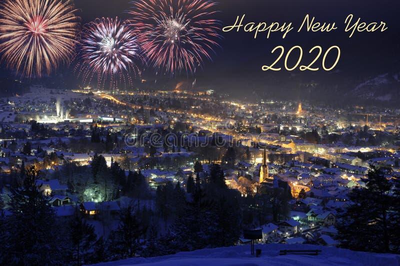 Happy new year 2020. With firework over city Garmisch-Partenkirchen stock photography