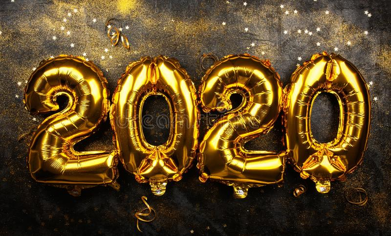 Happy New Year 2020. Golden baloons stock image
