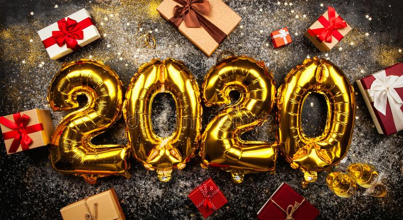 Happy New Year 2020. Golden baloons stock photo