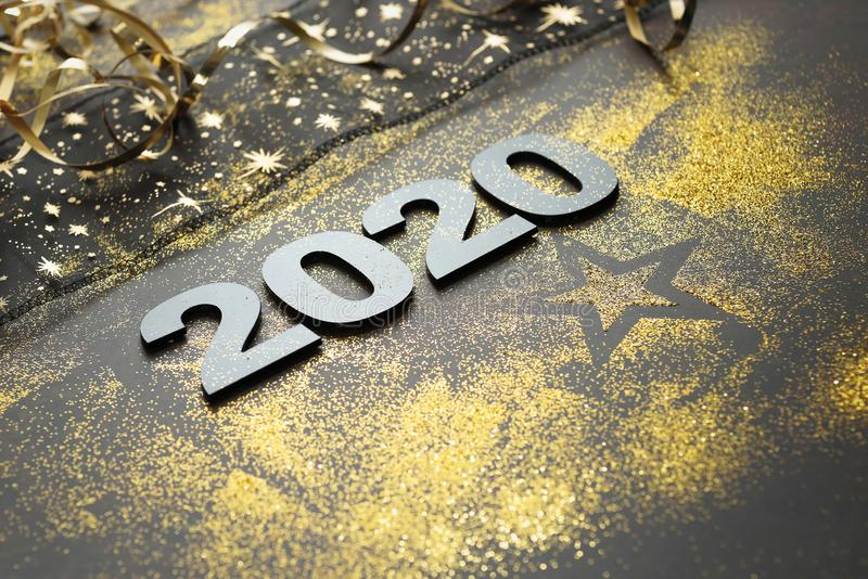 Happy New Year 2020. Symbol from number 2020 on stone background stock photography