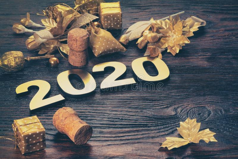 Happy New Year 2020. Symbol from number 2020 on wooden background stock images