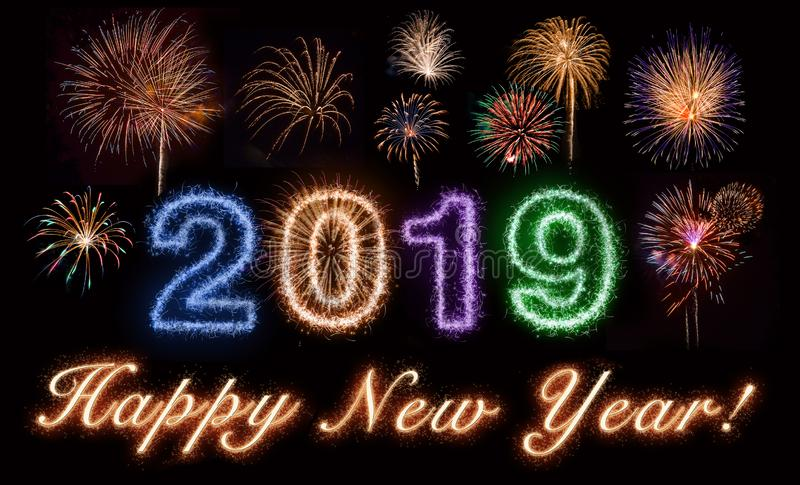 Happy New Year 2019. Written in fireworks text, with a cluster of fireworks, on black royalty free stock photo