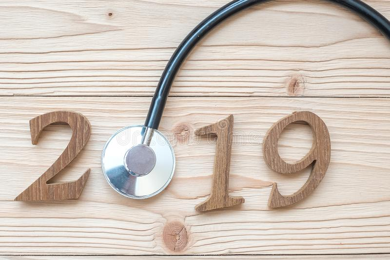 2019 Happy New Year for healthcare, Wellness and medical concept. Stethoscope with wooden number on table. Background stock photo