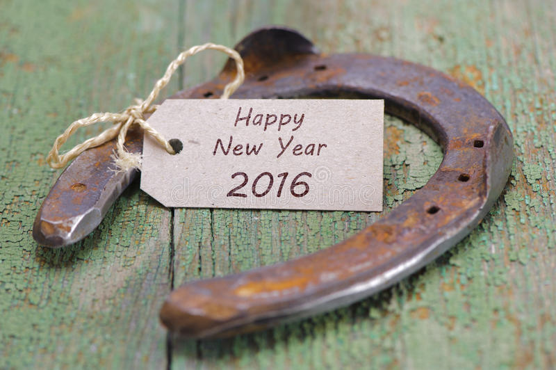 Happy new year 2016 with horse shoe stock image
