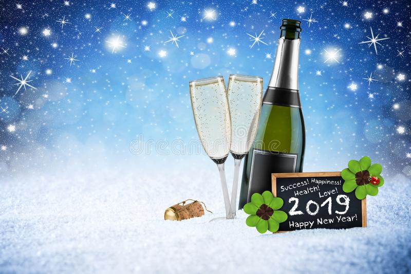 Happy new year 2019 ice blue snow night stars sky bokeh background. Champagne bottle glass cork blackboard greeting card royalty free stock photo