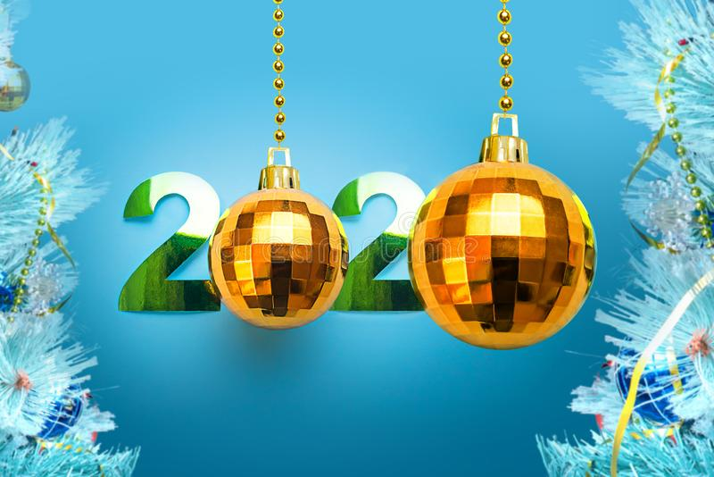 Happy New Year 2020. Illustration made of paper and Christmas tree toys, Golden disco balls on a blue background stock images