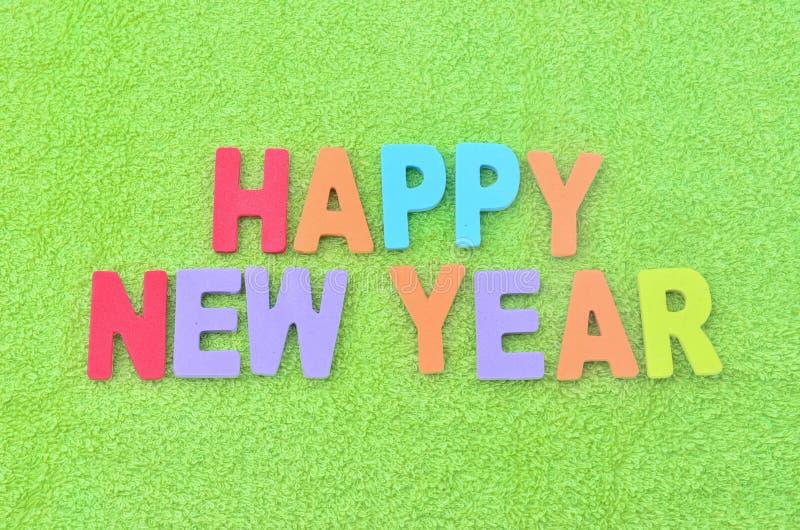 Happy New Year. Image of Happy New Year text on green fabrics stock photo