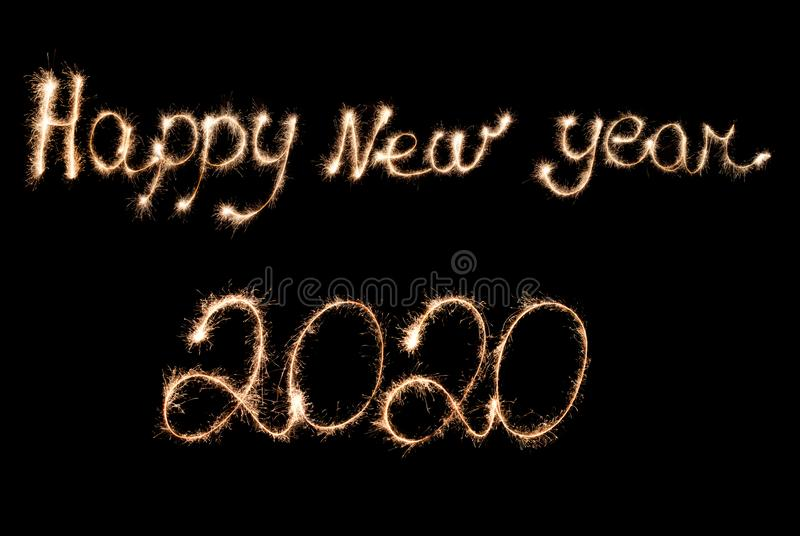 Happy New Year 2020 inscription with sparklers stock image