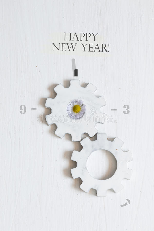 Happy New Year. Inscription Happy New Year the white background and gears royalty free stock photography