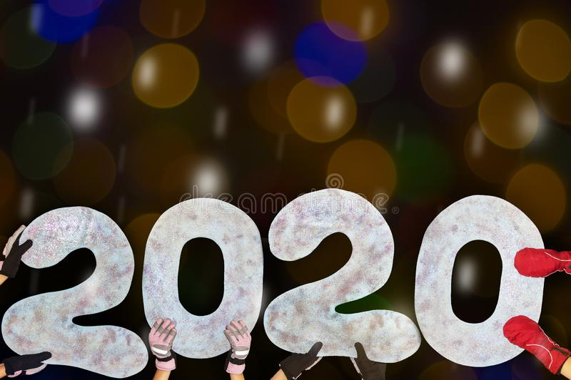 Happy new year 2020 isolated on black background with copy space for text, for holiday card. Blurred snowflakes, snow royalty free stock photography