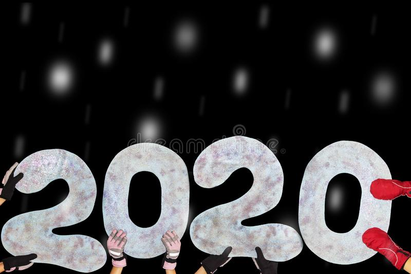 Happy new year 2020 isolated on black background with copy space for text, for holiday card. Blurred snowflakes, snow. royalty free stock photos