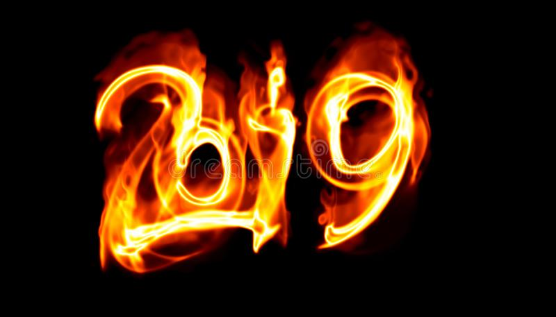 Happy new year 2019 isolated numbers lettering written with white fire flame or smoke on black background.  royalty free stock image