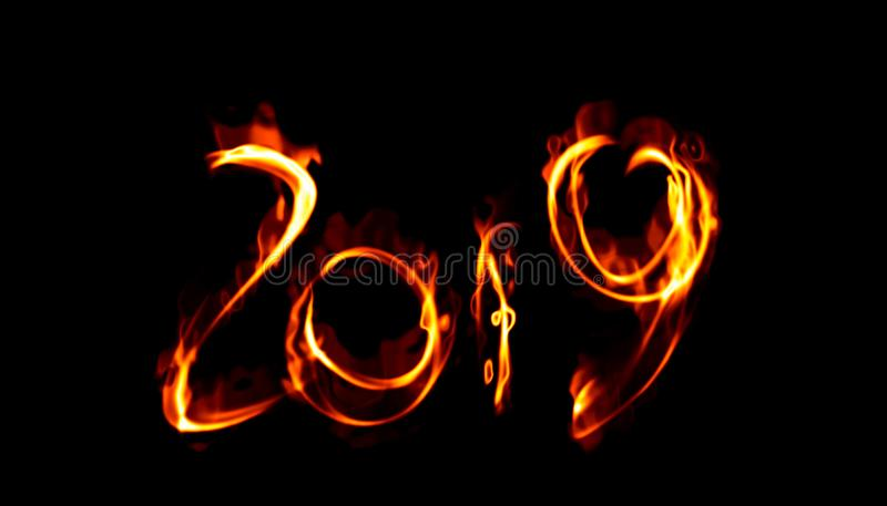 Happy new year 2019 isolated numbers lettering written with white fire flame or smoke on black background.  royalty free stock photo