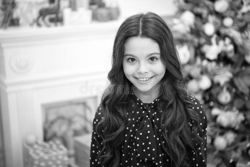 Happy new year. Kid enjoy the holiday. small happy girl at christmas. The morning before Xmas. New year holiday. little. Child girl likes xmas present stock photo