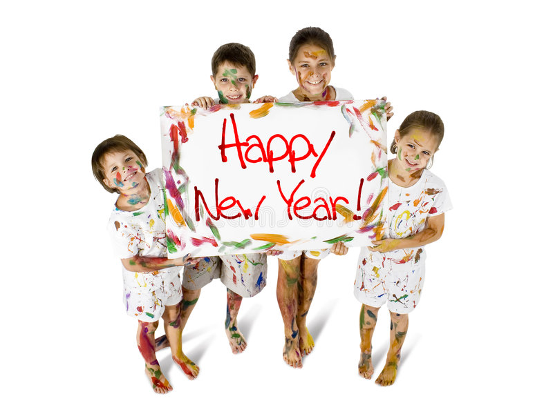 Happy New Year Kids. Kids covered in paint with sign reading Happy New Year stock image