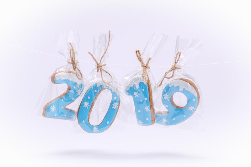 Happy New Year 2019 with letters Christmas Decorations Gingerbread cookies on white background greeting card stock photos