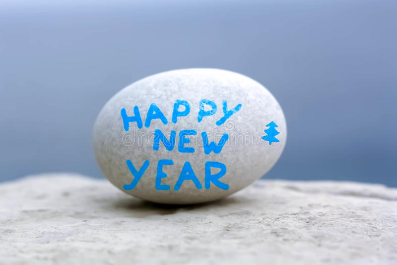 Happy New Year. Letters on white stone egg stock image