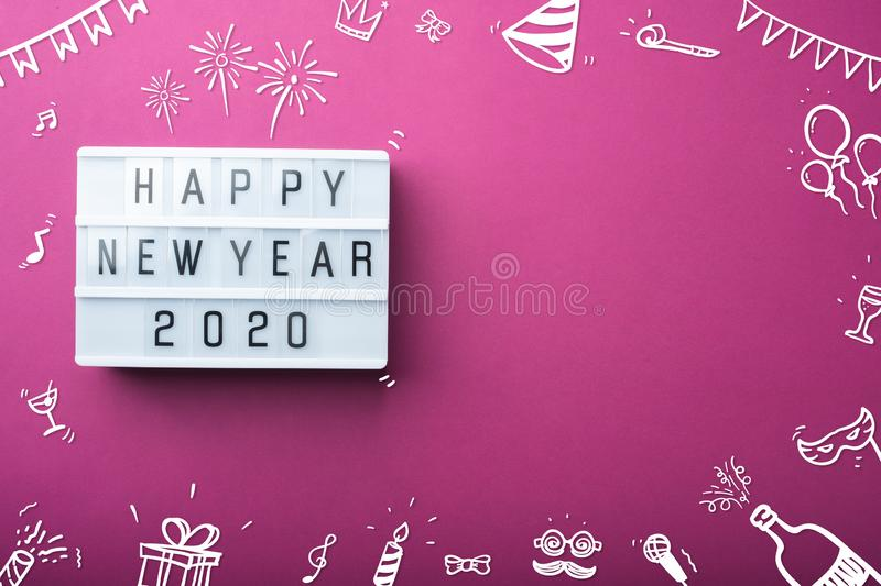 Happy new year 2020 light box with doodle party item decoration holiday festive item top view on purple background table with copy stock photography